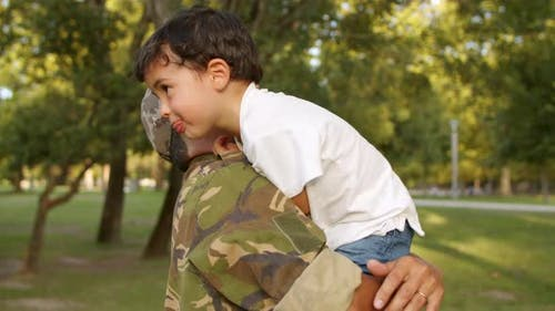 Strong Military Daddy Holding Little Son in Arms