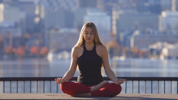 Thumbnail for Woman Meditating Yoga Lotus Pose Relaxed Breathing Stress Free Relief In Busy City Urban Lifestyle