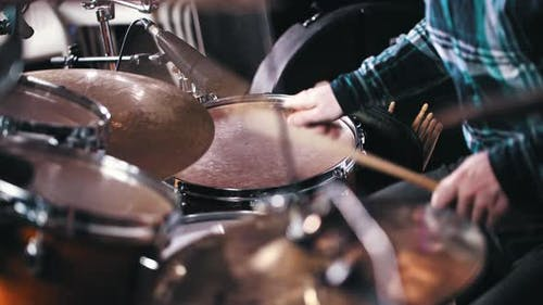 Young Music Band Member Playing Drums in the Record Studio