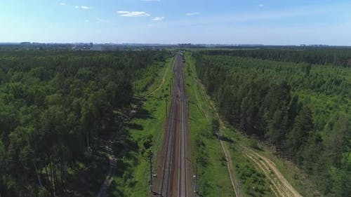 Two-track Railway. The Camera Moves Along the Rail Direction