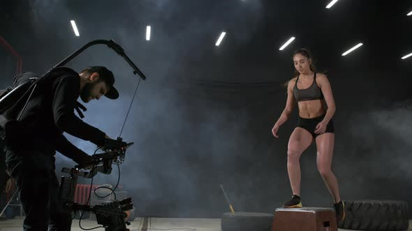 Thumbnail for Woman Demonstrating Energetic Box Jumps