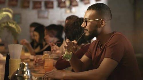 Portrait of Black Man at Bar Counter