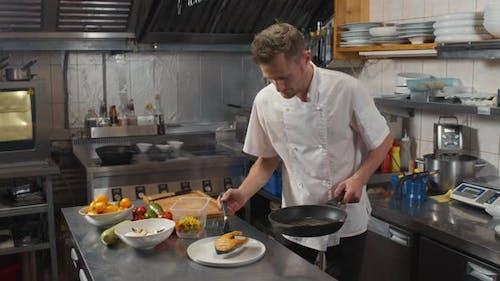 Chef Serving Salmon Steak On Plate
