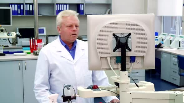 Thumbnail for Man Puts His Hand on Computer at the Laboratory
