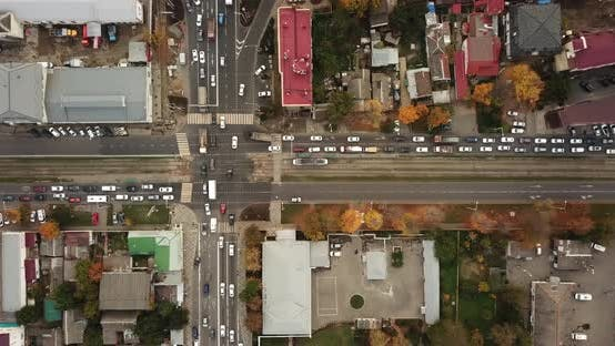 Thumbnail for Top Down Drone Point of View - Steet City Road Intersection in Autumn Time
