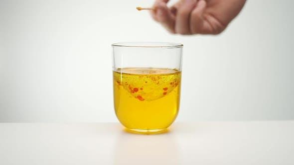 Stirring Liquid. Orange Red Liquid.