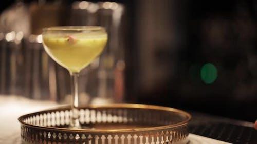 Bartender Putting Glasses of Cocktails at Bar
