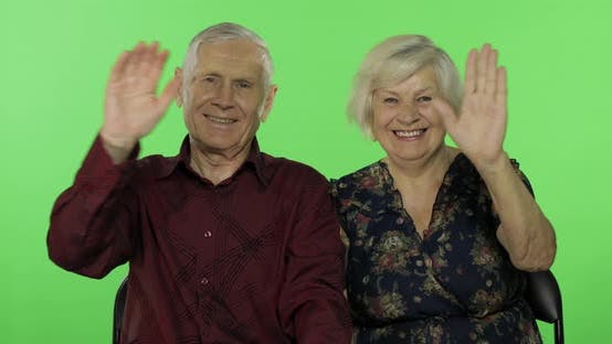Thumbnail for Elderly Man Hugging a Senior Woman and She Falls on His Shoulder. Chroma Key