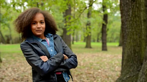Thumbnail for Young Happy African Girl Change Pose with Based Arms in the Forest