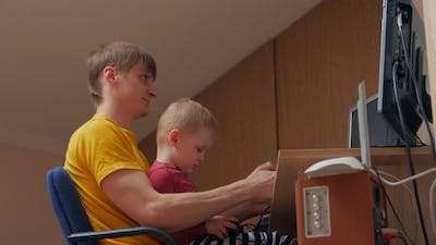 Man And Boy Playing Computer Games