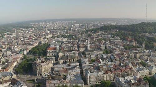 Aerial Drone Video of European City Lviv Ukraine Rynok Square Central Town Hall Dominican Church