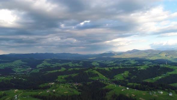Mountain Village Under Cloudy Sky