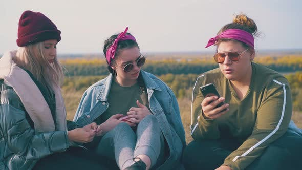 Thumbnail for Girl Hikers with Smartphone and Thermos on Green Meadow