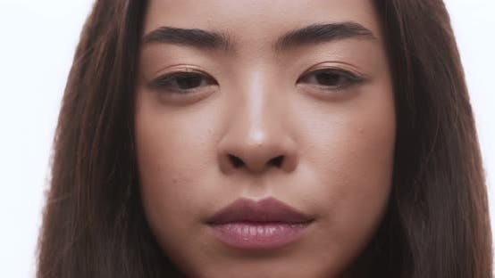 Thumbnail for Close Up Portrait of Pretty Asian Girl Smiling at Camera