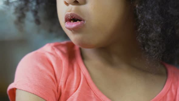 Thumbnail for Close up Of African American Female Child Chewing Cookie, Unhealthy Food