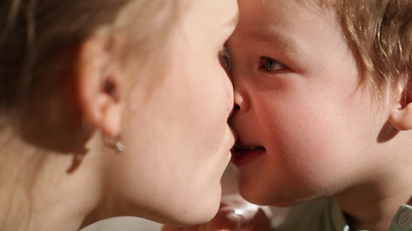 Thumbnail for Mom And Her Son Kissing