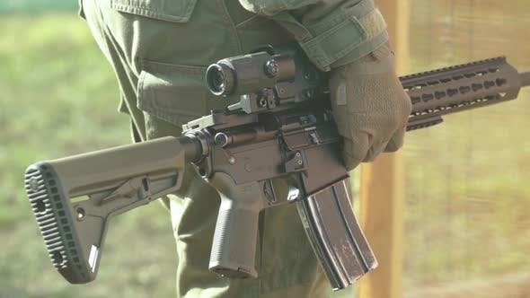 Thumbnail for Rifle in the Hands of a Shooter During Shooting. Slow Motion. Close-up.