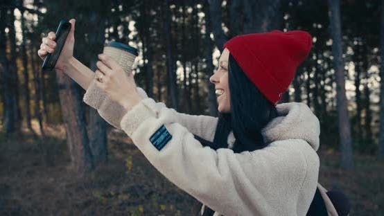 Thumbnail for Young Female Smiling And Taking A Selfie