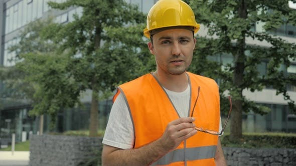 Thumbnail for Male Industrial Engineer in Hard Hat and Safety Jacket