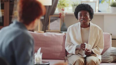 Upset Black Woman Speaking with Counseling Psychologist