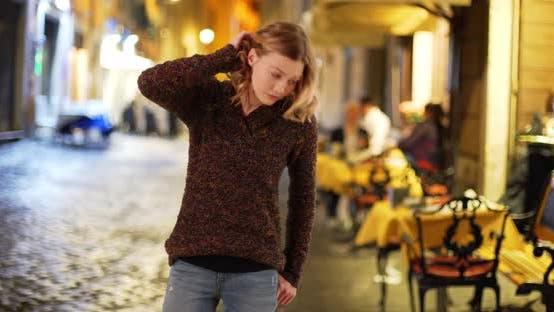 Thumbnail for Pretty Caucasian girl on urban street at night