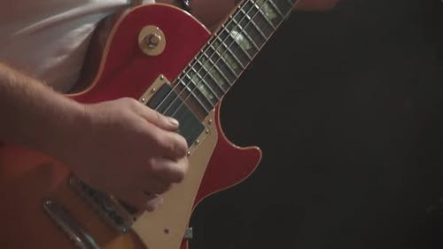 Guitarist Plays the Guitar at a Concert As Part of a Musical Group