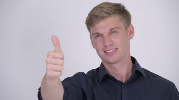 Thumbnail for Face of Young Happy Blonde Businessman Giving Thumbs Up