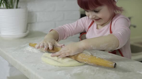 Thumbnail for Cooking Pizza. Little Child in Apron Roll Dough with Rolling Pin at Home Kitchen