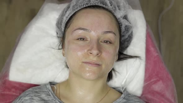 Thumbnail for Portrait of Woman in Beauty Clinic Salon. Girl with Moisturizing Mask on Face