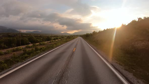 Thumbnail for Driving a Car on a Road in Norway at Dawn