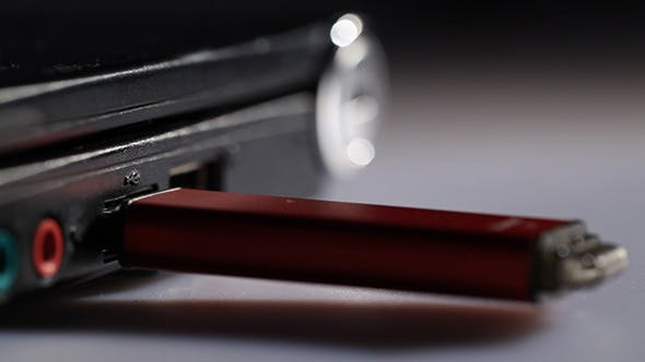 Thumbnail for Inserting Red USB Flash Drive In Notebook