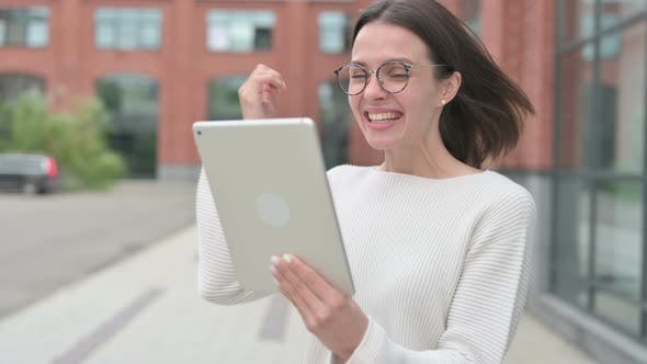 Woman Celebrating on Tablet, Outdoor