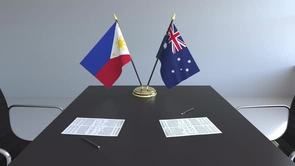 Flags of the Philippines and Australia and Papers on the Table