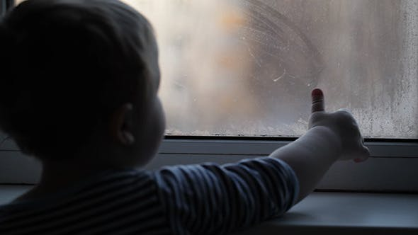 Cover Image for Little Boy Watching Through The Misted Window