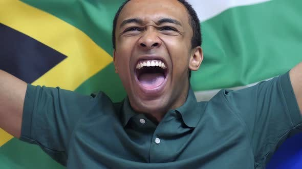 Thumbnail for South African Fan celebrates Holding the Flag of South Africa