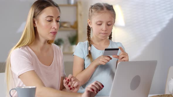 Thumbnail for Mother and Daughter Paying with Card Online