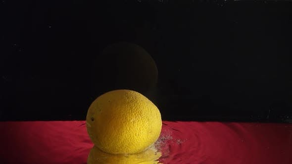 Thumbnail for Lemon Under Water Whith Bubbles in Slowmotion