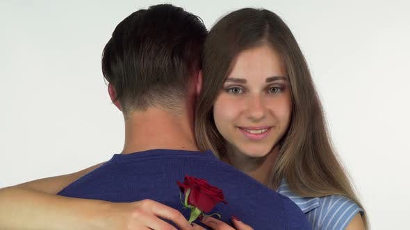 Thumbnail for Beautiful Woman Smiling, Holding Red Rose While Embracing Her Boyfriend 1080p