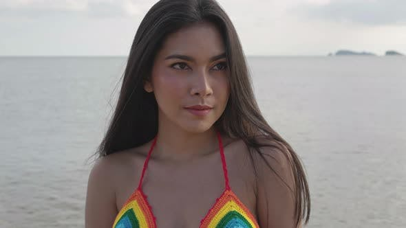 Portrait of Asian woman at the beach