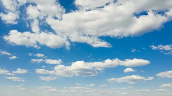 Thumbnail for Beautiful White Clouds Floating At The Blue Sky On A Sunny Day