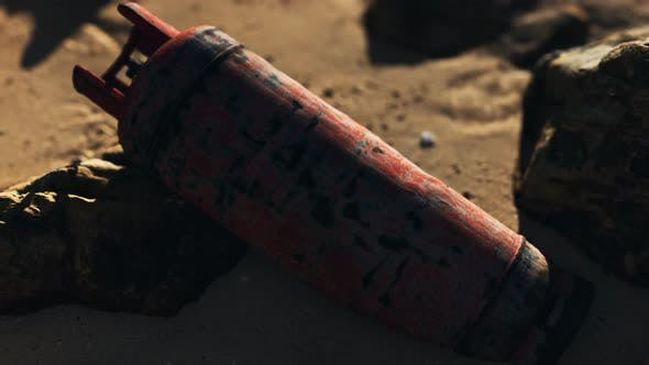 Old Rusted Gas Tank on Sand Beach