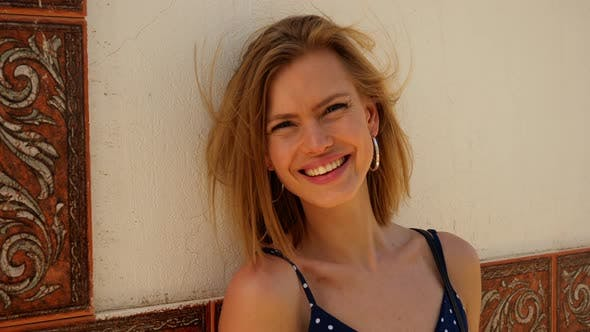 Thumbnail for Gorgeous Woman Leaning Against the Cement Wall Smiling