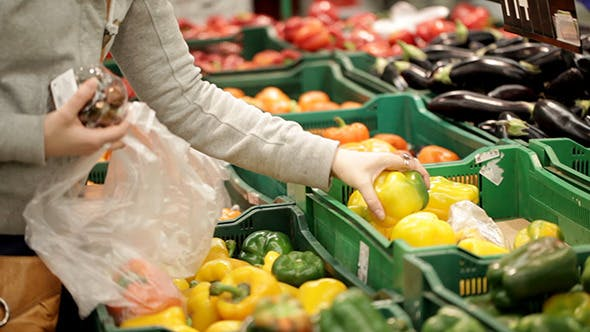 Thumbnail for Woman In A Supermarket Choosing Vegetables