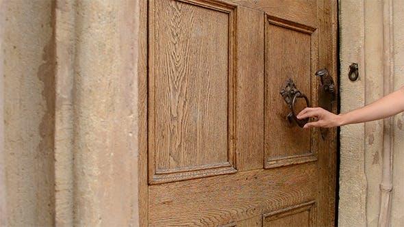 Thumbnail for Woman Uses Door Knocker