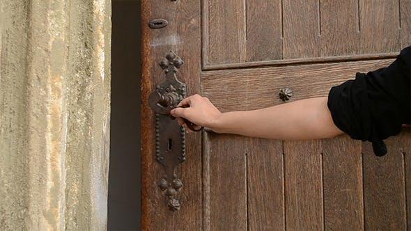 Thumbnail for Woman Push Old Door Handle