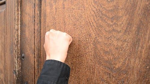 Knocking on Wooden Door