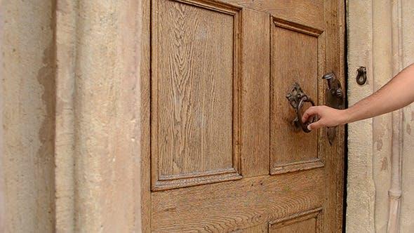 Thumbnail for Man Uses Door Knocker