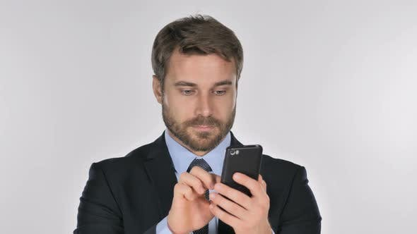 Thumbnail for Businessman Browsing Smartphone