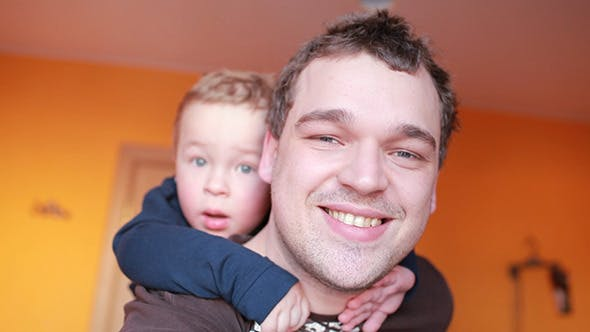 Thumbnail for Close Up Portraits Of Happy Father And His Son