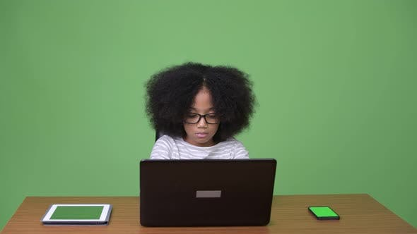 Thumbnail for Young Cute African Girl with Afro Hair Using Laptop